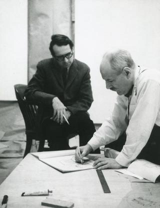 Newman working on his synagogue project as Richard Meier looks on, 1963. Photo by Jonathan Holstein