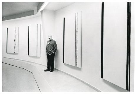 Newman at his exhibition _The Stations of the Cross: Lema Sabachthani_ at the Solomon R. Guggenheim Museum, 1966. Photo by Bernard Gotfryd/Newsweek/Getty Images