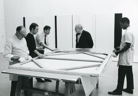 Newman at the installation of his exhibition at the Solomon R. Guggenheim Museum, with Orrin Riley and art handlers, 1966. Photo by Robert Murray